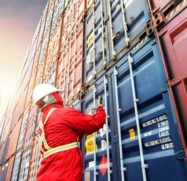 Illustrative photo of a man checking a container.